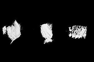 three white abstract paint strokes i
