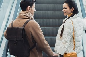 smiling couple in warm clothing hold