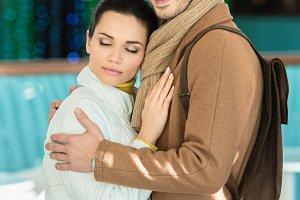handsome man embracing girlfriend, s