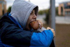 teenage homeless poor sad child eati
