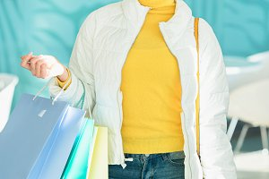 smiling girl holding shopping bags a