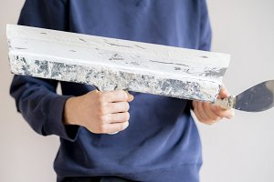 putty knife making the wall repair f