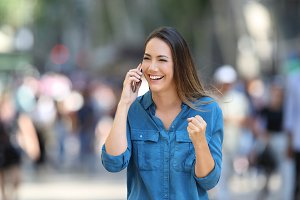 Excited woman receiving good news