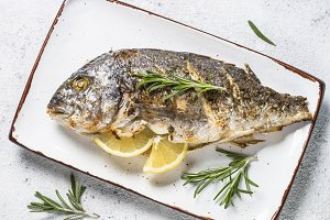 Baked dorado fish with lemon and