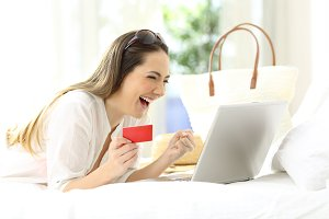 Excited woman buying online