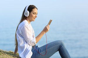 Girl listening to online music on