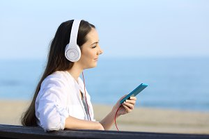 Girl listening to music relaxing
