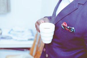Modern man drinking coffee