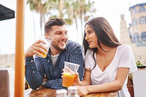 couple drinking beer in outdoor pub