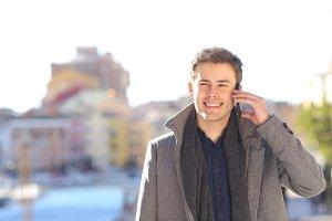 Happy man talking in phone
