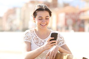 Happy lady uses a smartphone