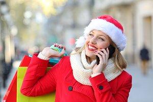 Happy shopper talking on phone