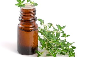 Bottle of essential oil with herbs