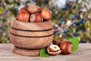 Hazelnuts with leaves in a wooden