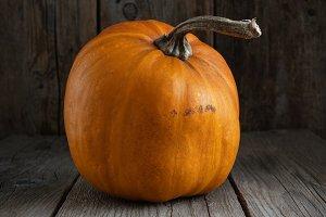 Pumpkin on wooden board.