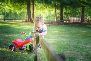 smiling blond curly child playing wi
