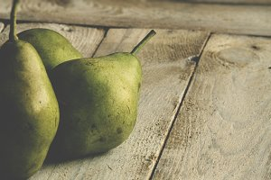 Organic grown pears at wood table