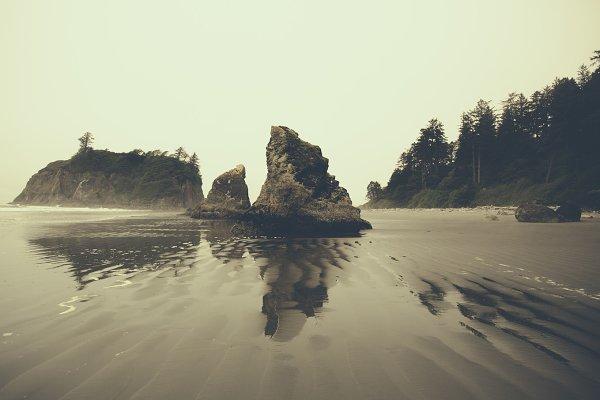 Dramatic Rocks along Foggy Beach