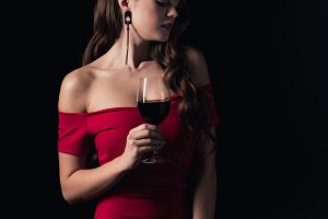 attractive woman in red dress holdin