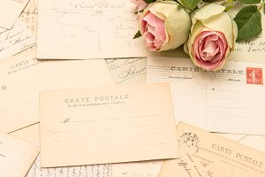 Vintage postcards and rose flowers