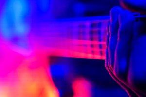 Rock concert. Guitarist plays on the