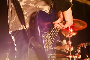 Rock concert. Guitarist plays the