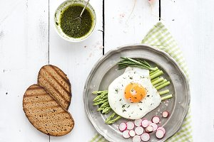 Fried egg with green asparagus