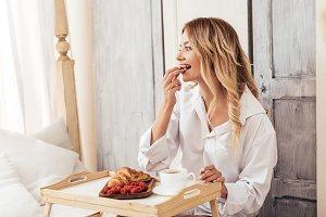 happy woman having breakfast with co
