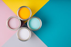 Four open cans of paint on bright