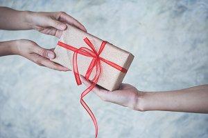 Hand holding gift box.