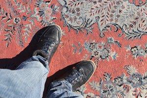 Man legs standing on turkish carpet