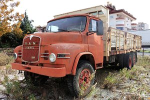 Weathered red retro rusty truck