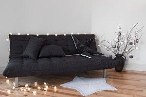 Cozy lights decorating gray sofa