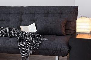 Gray sofa and cozy lights