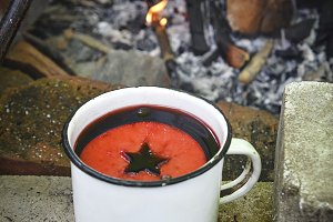 wine in an iron mug on near the fire