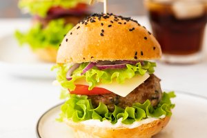 Delicious burgers with beef, tomato