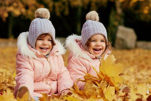 Two happy children in autumn clothes
