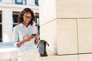 Businesswoman looking at phone