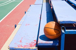 Basketball in bleachers