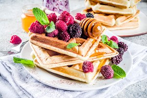 Belgian waffles with berries and hon