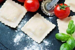 Uncooked ravioli with tomato