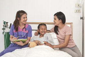 Doctor and child with mother in hosp