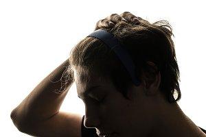 close up man pu on a hairband on hea