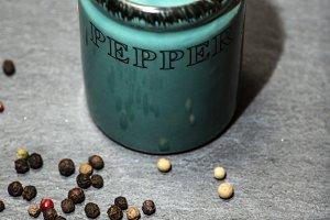 Black pepper shaker and beans on sto
