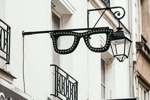 Sign board in shaped of glasses