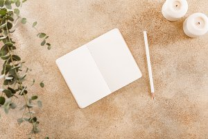 Open notebook with white pencil