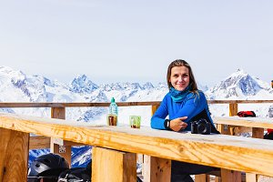 Tourist girl in a cafe on the mounta