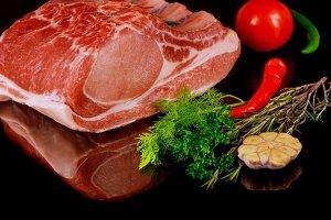 Raw juicy meat steaks on a board