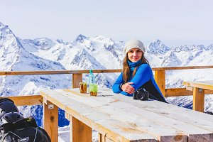 Woman snowboarder relaxing.