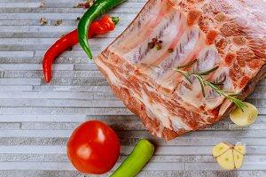Raw bone-in rib eye pork chops